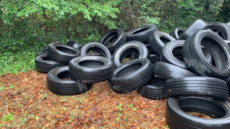 Tires are often discarded on the sides of country roads.