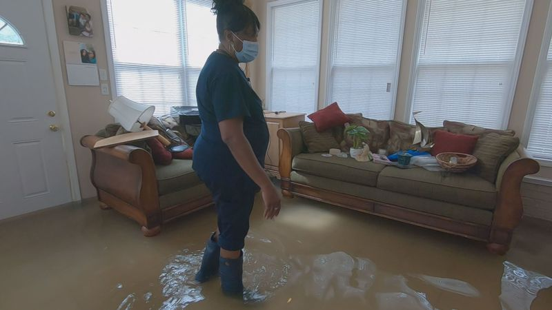 A Sumter woman's home is damaged by floodwaters after Thursday's storms.