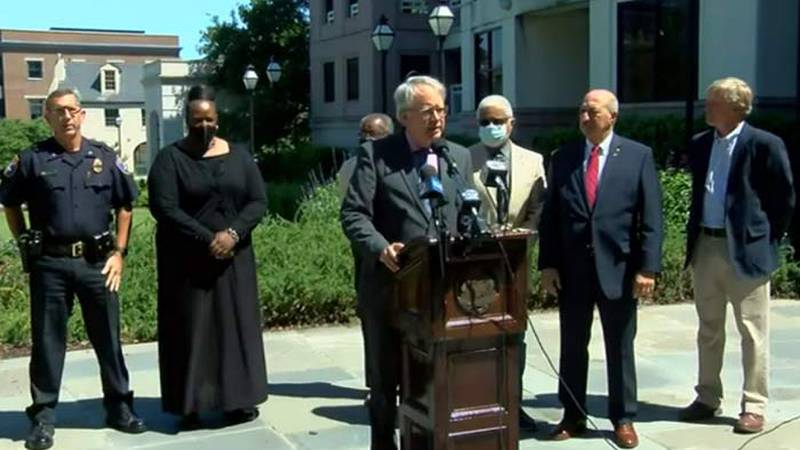 Mayor John Tecklenburg, joined by Police Chief Luther Reynolds, Charleston City Council members...