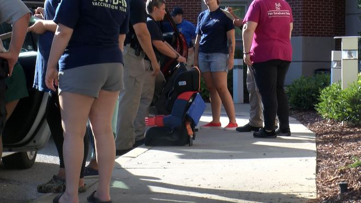 Law enforcement officials checked out car seats to make sure they were properly installed.