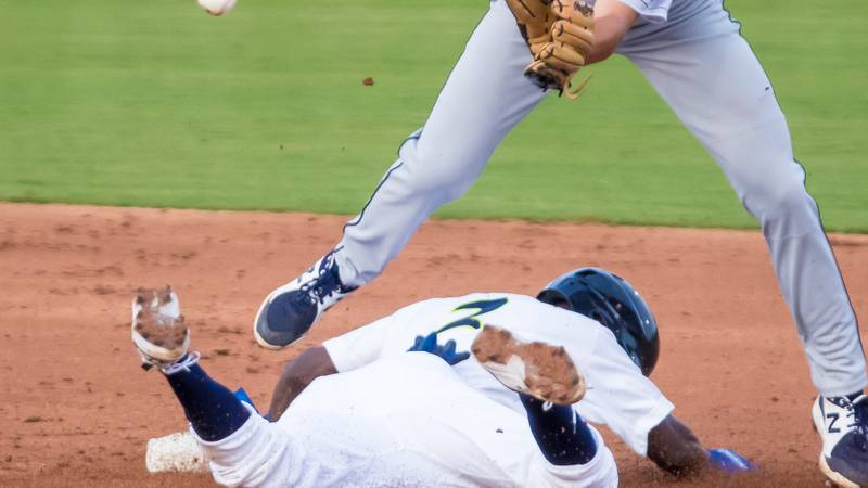 Tyler Tolbert slides in safely in a game vs. the Charleston Riverdogs.