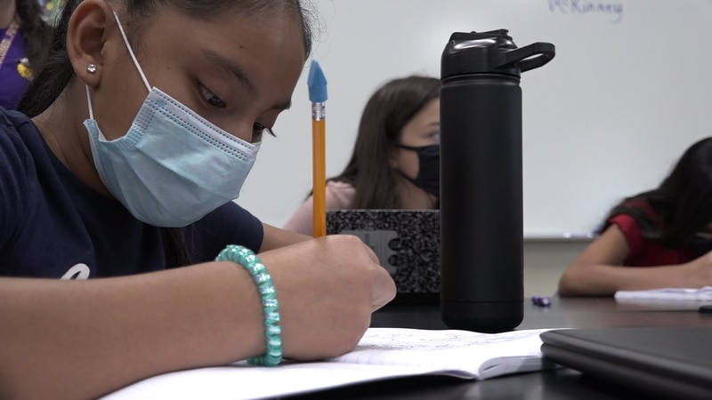 The city requires pre-k, elementary and middle school students to wear masks at school.