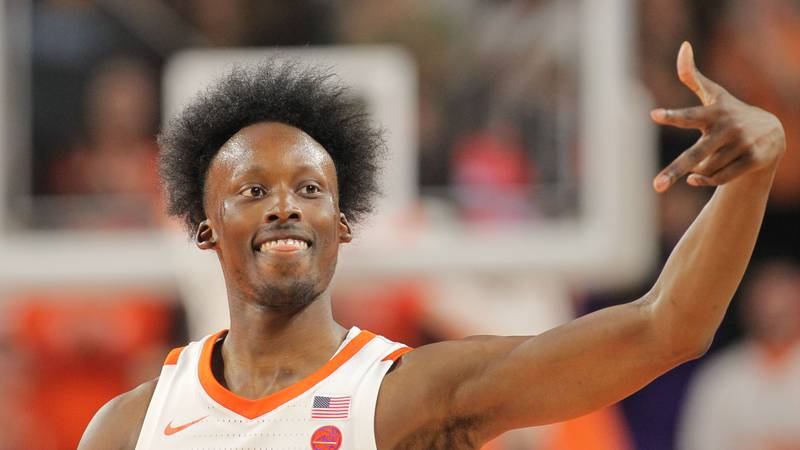 Clemson guard John Newman III (15) celebrates after knocking down a three-point shot against...