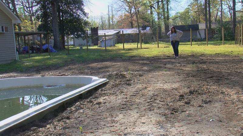 Horry County resident Kimberly Dailey stand in her incomplete yard nearly a year after she...