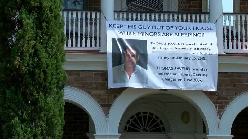 A banner is hanging outside a home on Murray Boulevard Charleston's historic Battery blasting...