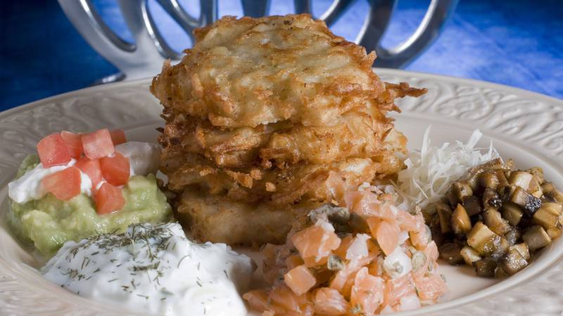 This Nov. 14, 2010 photo shows Laura Frankel's potato latkes surrounded by a variety of...
