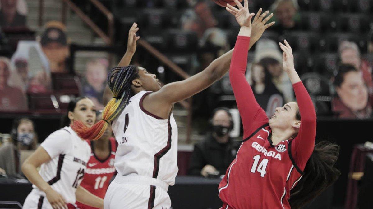 South Carolina Gamecocks forward Aliyah Boston (4) blocks Georgia Lady Bulldogs center Jenna...