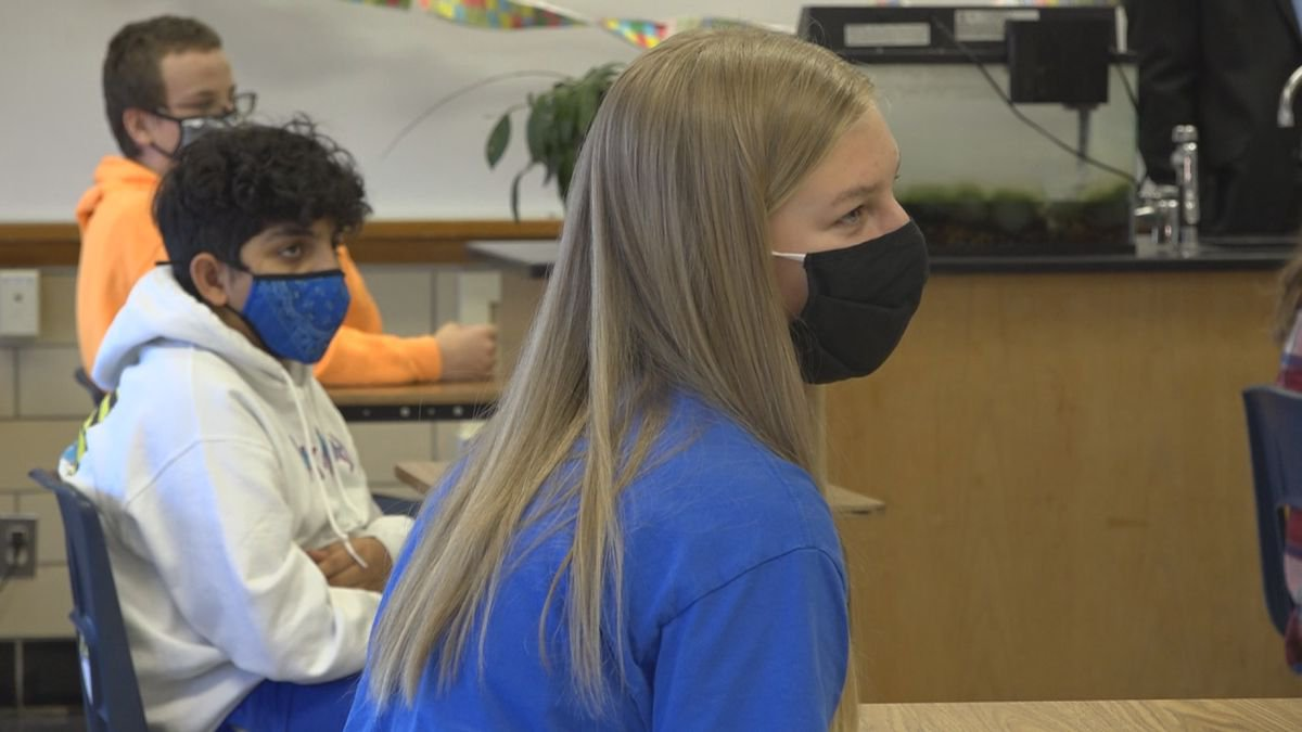 Students are required to wear face masks while sitting inside the classroom.