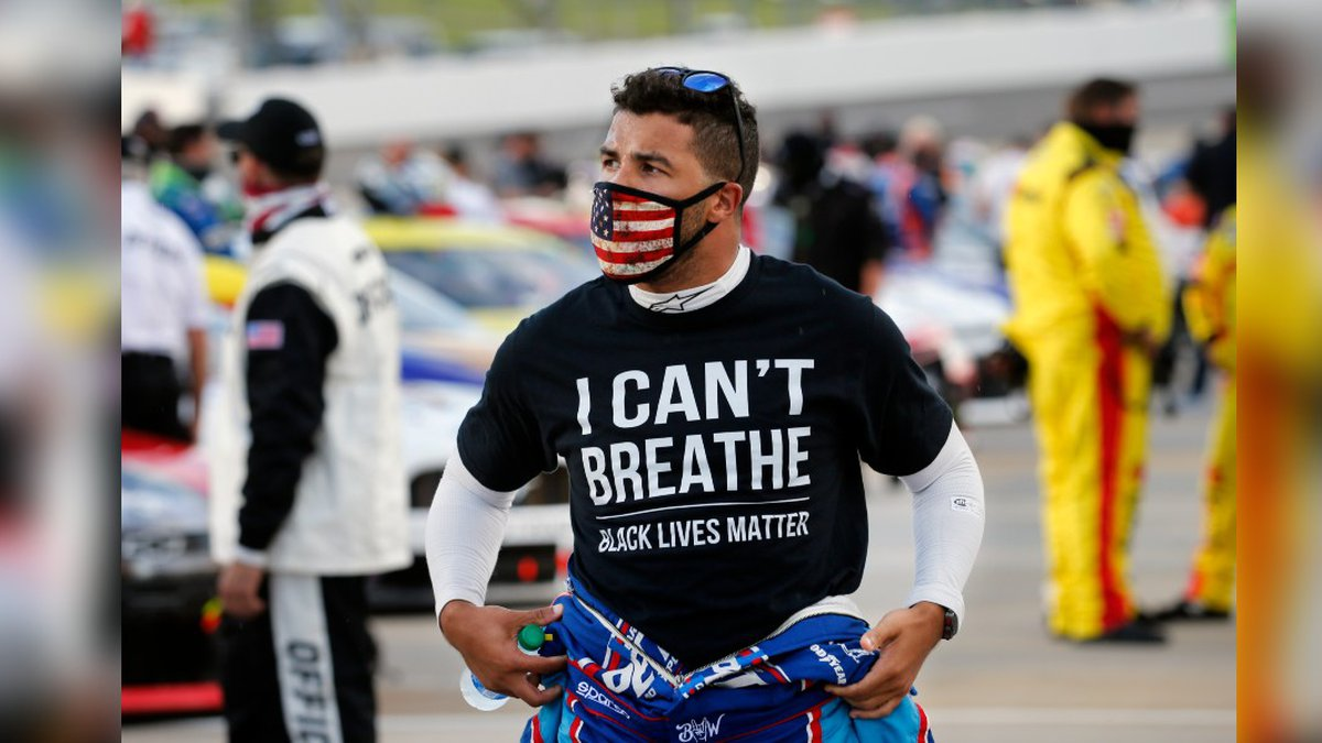 Driver Bubba Wallace wears a Black Lives Matter shirt as he prepares for a NASCAR Cup Series...