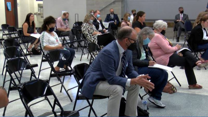 Parents and teachers at the meeting called for action to slow the spread of COVID-19 in...