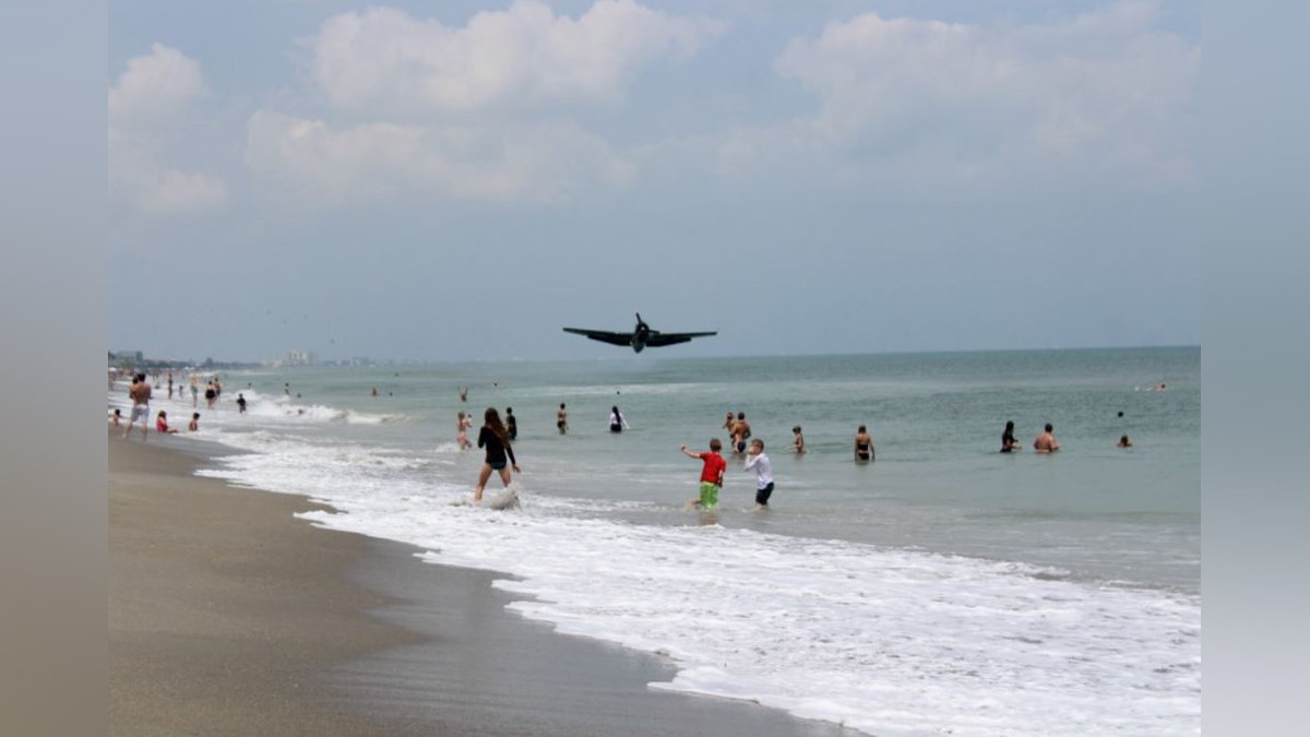 A WWII-era bomber plane crashed near the shoreline in Cocoa Beach, FL Sunday.