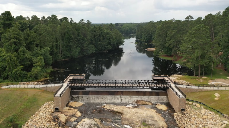 Historic flooding caused the Gibson Pond Park dam to breach in 2015 leaving the pond empty.