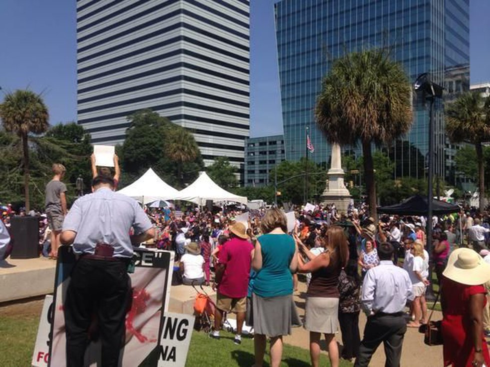 A crowd of people listen to speakers at Tuesday's rally at the South Carolina State House....
