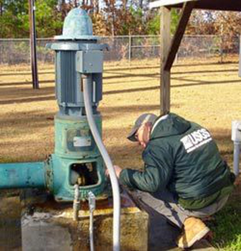 USGS worker collects groundwater from a well in Chesterfield County during an ongoing chemical...