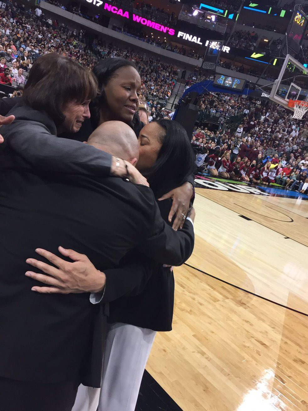 Head Coach Dawn Staley and her coaching staff embrace seconds before winning the 2017 NCAA...