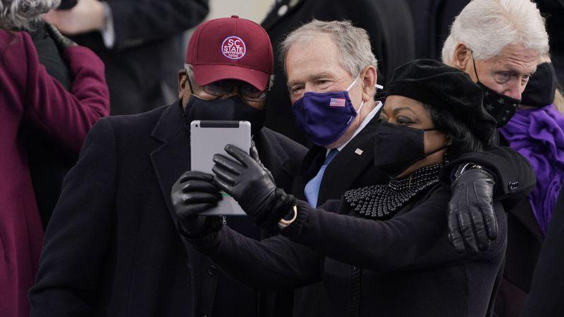 House Majority Whip James Clyburn of South Carolina, and former President George Bush, take a...