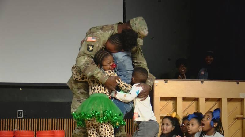Staff Sgt. Henry surprises his children at Harbison West Elementary.