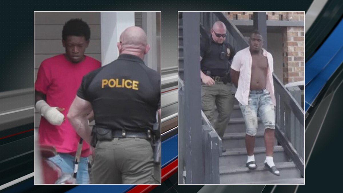 Police officers arresting Tyquan Denard Cooper and Manqual Laval Horlbeck who are being charged...