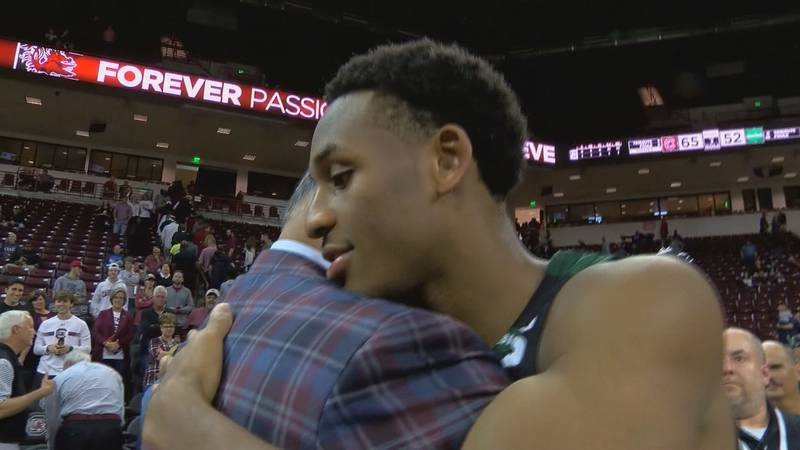 Frank Martin and his son Brandon hug following a game between the Gamecocks and USC Upstate on...