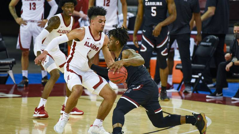 Trae Hannibal tries to get past an Alabama defender during a game at Colonial Life Arena on...