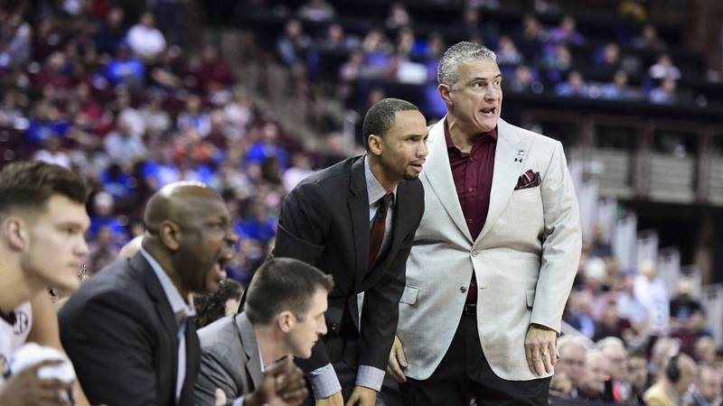 South Carolina head coach Frank Martin, right, assistant Bruce Shingler, and the rest of the...