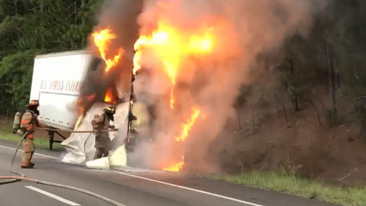 Lexington County firefighters battle flames after a semi-truck catches fire on I-20.