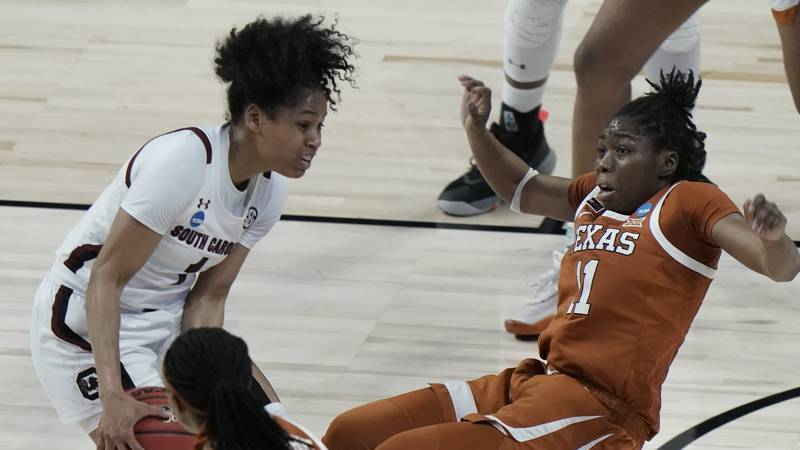 Texas's Joanne Allen-Taylor draws a charge on South Carolina's Zia Cooke during the first half...