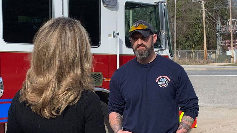 Firefighter Chastain Cannon speaks with WIS anchor Dawndy Mercer Plank after returning to work...