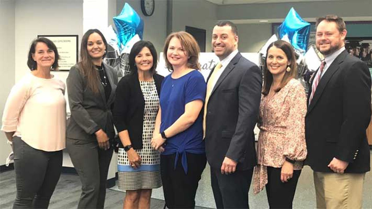 Mrs. Amy Carter (in blue) teaches at Chapin High School.
