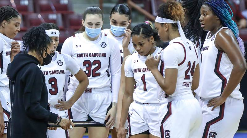 Coach Dawn Staley talks to her team bench the first half of action against Florida in the...