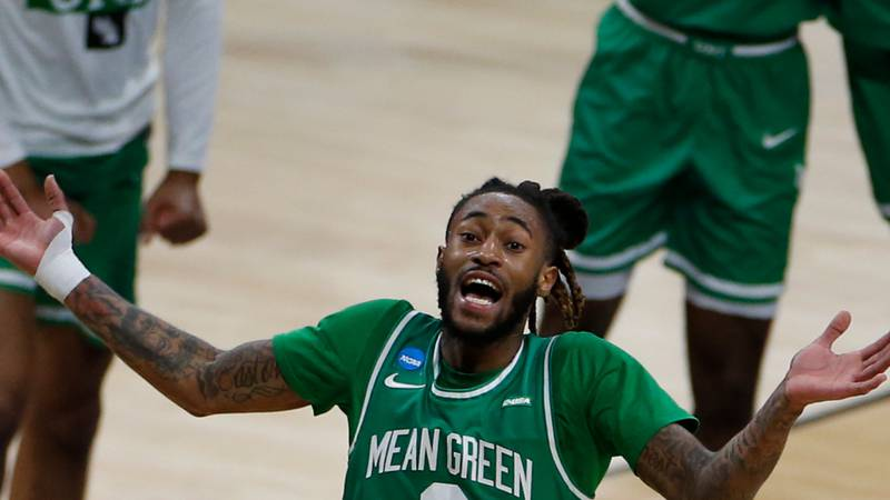 INDIANAPOLIS, IN - MARCH 19: James Reese of the North Texas Mean Green celebrates their win...