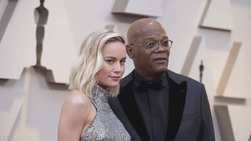 Brie Larson, left, and Samuel L. Jackson arrive at the Oscars on Sunday, Feb. 24, 2019, at the...