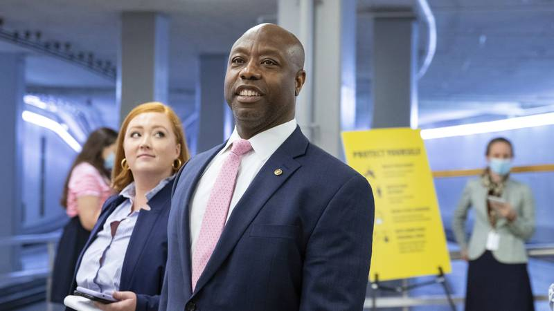 FILE - Sen. Tim Scott, R-S.C., speaks to reporters amid ongoing negotiations on the...