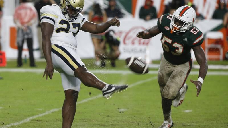 Georgia Tech punter Pressley Harvin III (27) kicks the ball as Miami linebacker Zach McCloud...