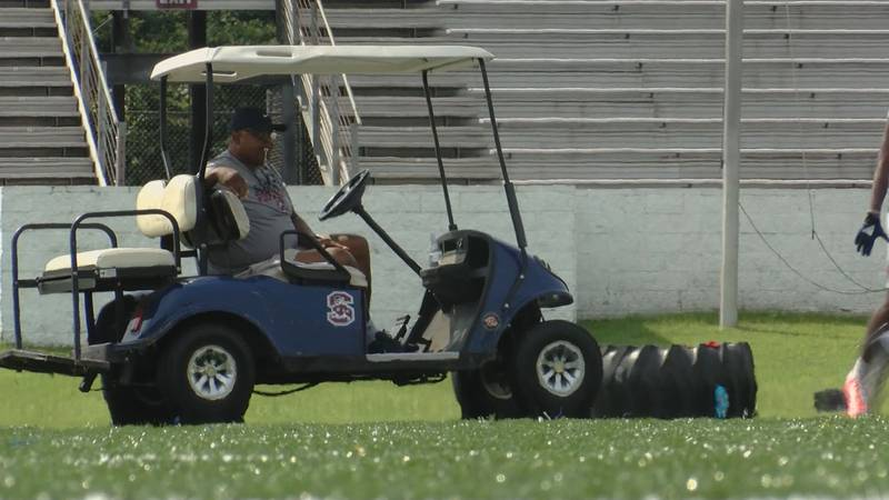 Head coach Buddy Pough observes Monday's preseason practice.