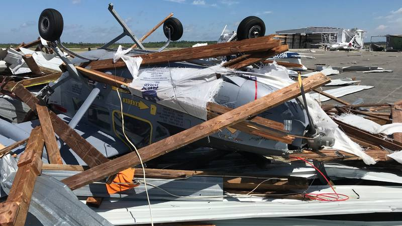 A powerful line of storms early Monday morning damaged more than two dozen planes, destroying...