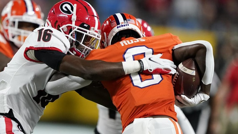 Clemson wide receiver Justyn Ross is tackled by Georgia defensive back Lewis Cine (16) during...