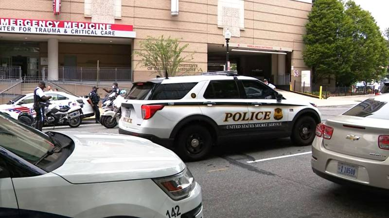 Police officers stand outside a Washington, D.C.-area hospital after violence Tuesday near the...