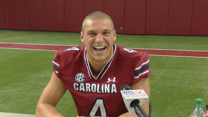 South Carolina's starting quarterback smiles ahead of the first day of fall camp when meeting...