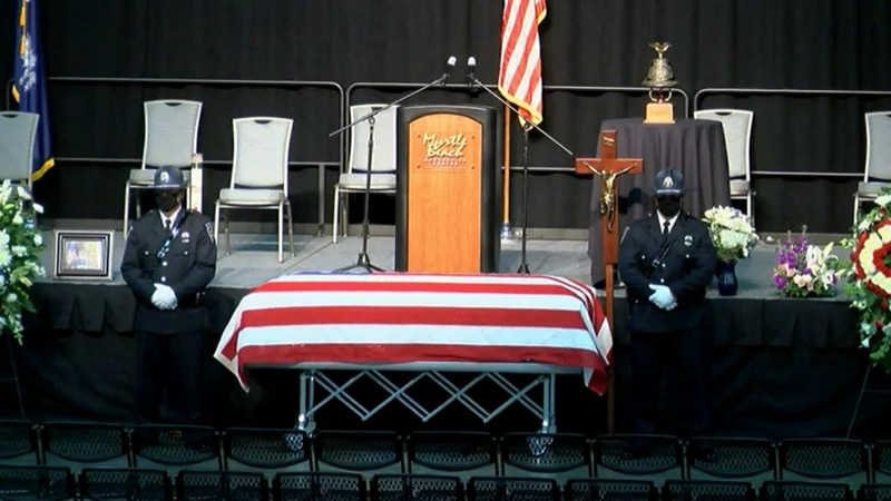 Two officers stand beside the casket of Myrtle Beach Police Ofc. Jacob Hancher ahead of the...