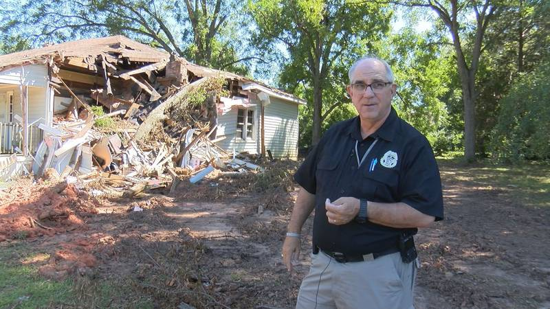 Newberry County Sheriff Lee Foster stands in front a damaged home on Drayton Street.