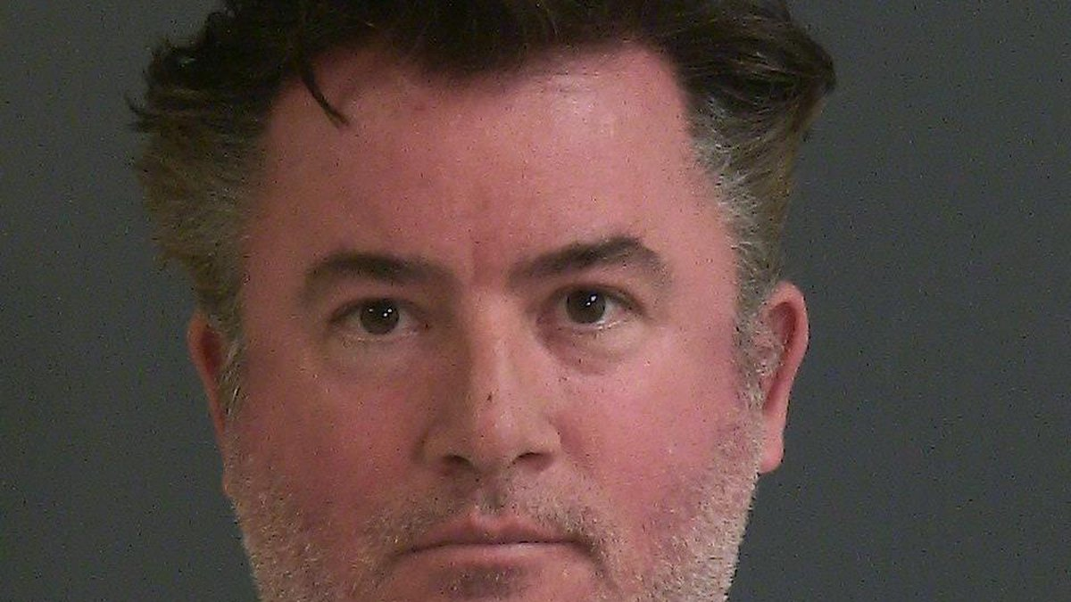 John David Madison, 45, was charged with check violation greater than $500 and less than...