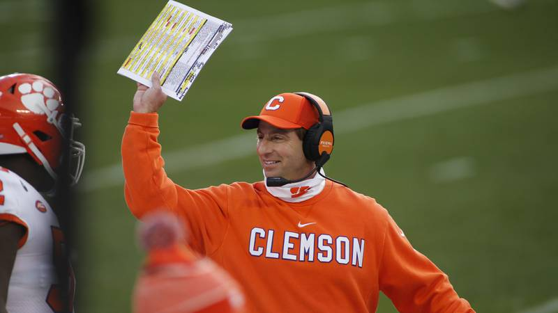 Dabo Swinney smiles on the sideline during the ACC Championship Game at Bank of America Stadium...