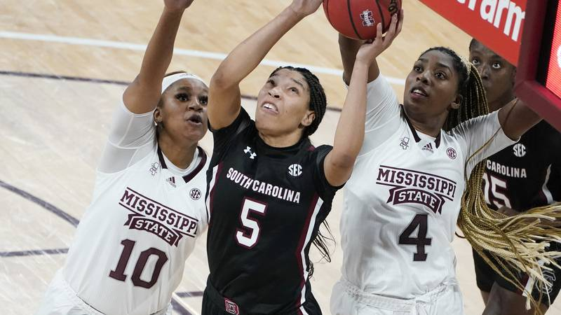South Carolina forward Victaria Saxton (5) shoots while defended by Mississippi State forwards...