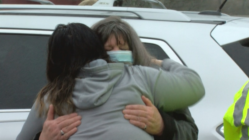 Family members embrace as authorities search for 18-year-old Jackson Garcia in Sumter County.