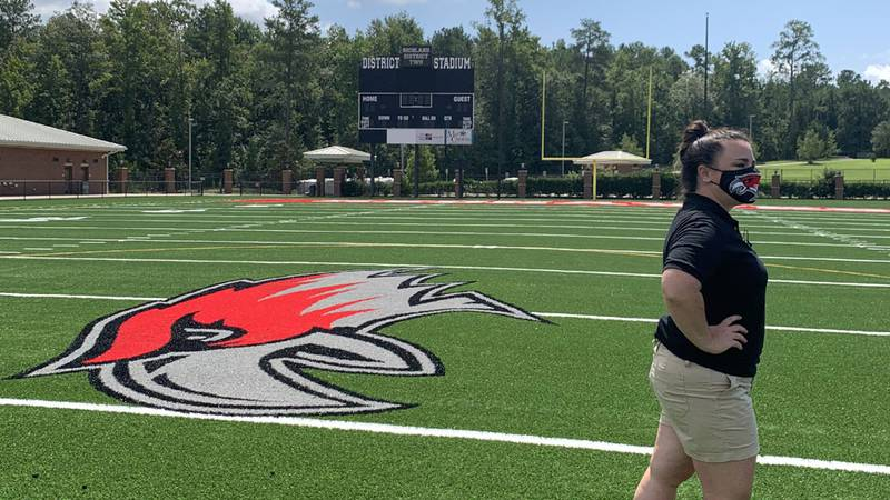 Heather Johnson stands near midfield at Richland Two Stadium at Westwood High School. Johnson...