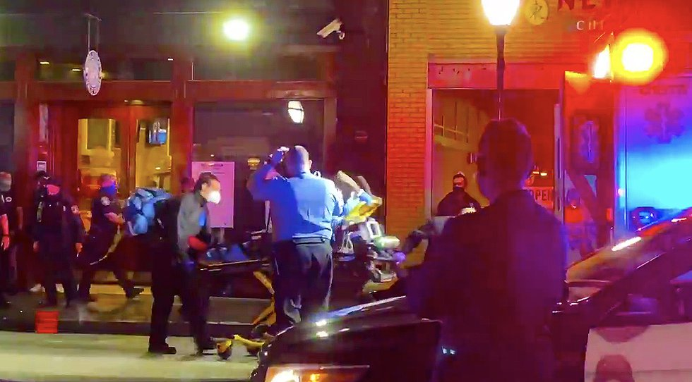 Emergency crews transporting the victim of a shooting that happened at King Street Public House...