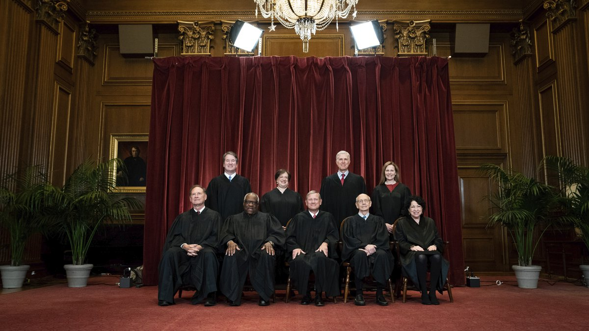 Members of the Supreme Court pose for a group photo at the Supreme Court in Washington, Friday,...